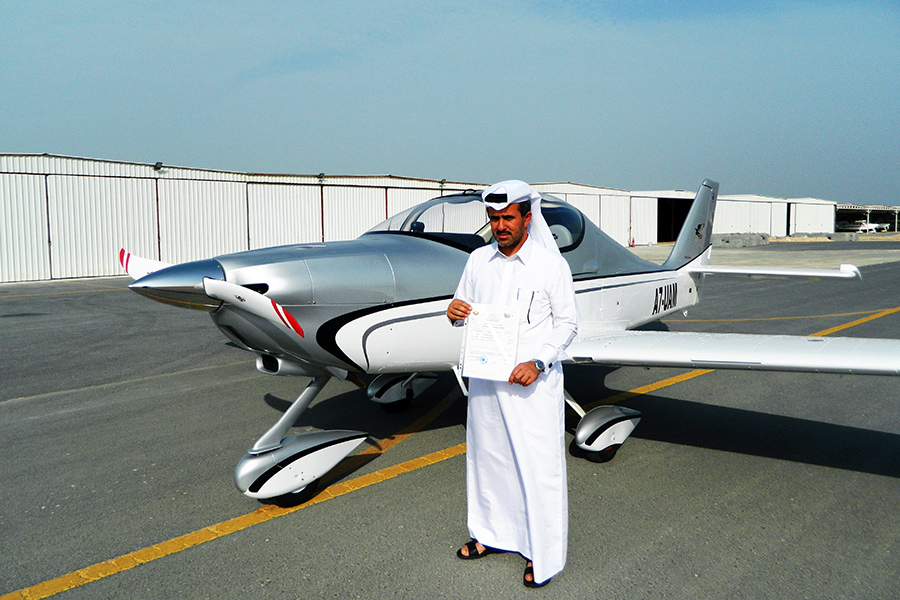 Khalid al Kather, Tecnam Qatar shows the certification with the Astore in the background