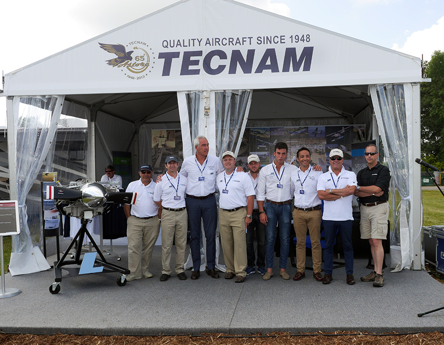 Tecnam team, Oshkosh 2014. From left to right Phil Solomon, Gryphon Mc Arthur, Paolo Pascale (President TECNAM US Inc.), Shannon Yeager, Fabio Russo, Giovanni Pascale, Walter Da Costa, Joe Martinez & Michael J Kraft (Senior Vice President & General Manager Lycoming Engines, a division of Avco Corporation)
