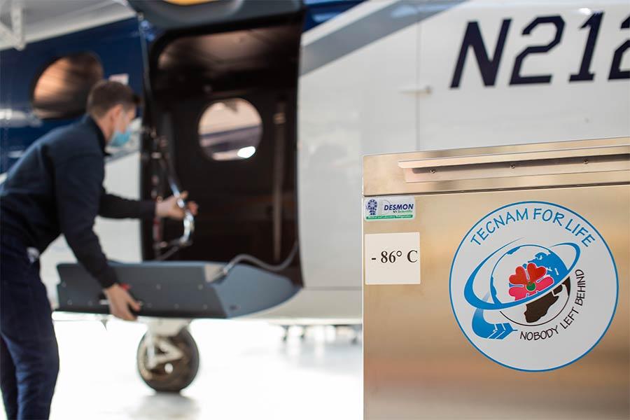 loading DESMON ultra-freezer for COVID vaccine storage to Tecnam's P2012 TRAVELCARE aircraft